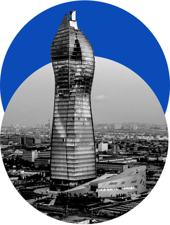 Photograph of a skyscraper with a blue circle behind it.